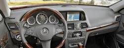 Mercedes E550 dashboard with Optional Warning Light Dome in center near windshield