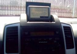 Dealer Installed storage box above radio